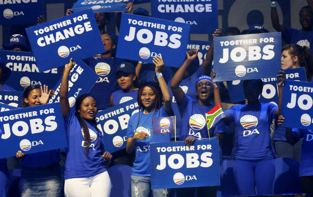 Supporters cheer as they wait for opposition Democratic Alliance leader Helen Zille to address her party's final election rally in Johannesburg May 3, 2014. South Africa goes to the polls on May 7 in elections which are expected to keep President Jacob Zuma's African National Congress (ANC) in power. REUTERS/Mike Hutchings (SOUTH AFRICA - Tags: POLITICS ELECTIONS)