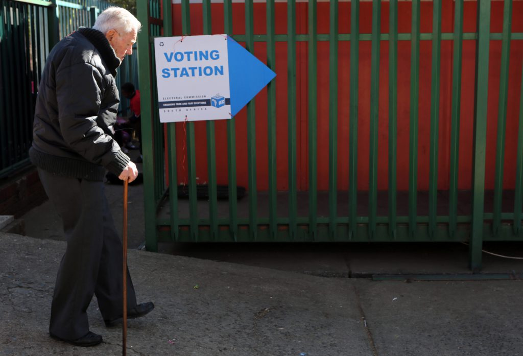 An elderly voter arrives at a polling station to cast an early vote on the eve of the country's municipal elections in Johannesburg, Tuesday, Aug. 2, 2016. This election season has been deadly for candidates and party activists in South Africa, with more than 12 killed ahead of Wednesday's vote. National police have determined it a serious enough problem to create a task force to investigate the deaths, most occurring in KwaZulu-Natal province. (AP Photo/Denis Farrell)