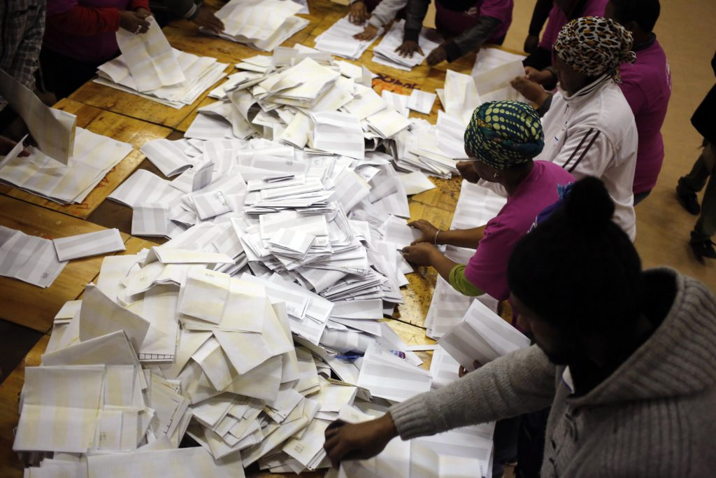 Election officials start the ballot counting process at a polling station during municipal elections in Manenberg on the outskirts of Cape Town, South Africa, Wednesday, Aug. 3, 2016. South Africans voted Wednesday in municipal elections described as the most closely contested for the African National Congress since it took power in the first all-race elections in 1994. (AP Photo/Schalk van Zuydam)